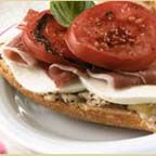 Prosciutto Panini with Mozzarella and White Bean Puree - Simply irresistible! Roasted garlic-infused white bean purée is spread onto French bread and topped with fresh mozzarella, shaved prosciutto, strips of roasted red bell pepper, juicy ripe slices of Roma tomatoes and fresh basil leaves. Recipe by Chef Seth Bixby Daugherty.