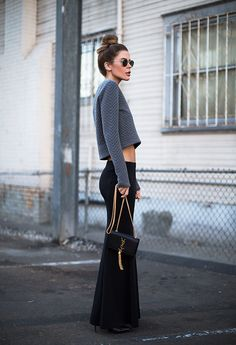 How To Street Style: NEW OUTFIT FROM THE STREET black pants cropped grey long sleeve top. YSL purse