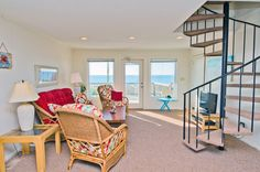 Glasshouse East a 4 Bedroom Oceanfront Rental Duplex in Emerald Isle, part of the Crystal Coast of North Carolina. Includes Hi-Speed Internet