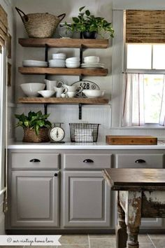 rustic kitchen shelves and window covering.