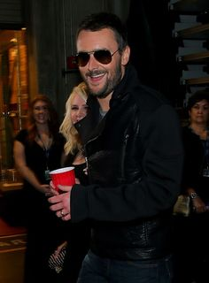 Eric Church & wife backstage at the 57th Annual GRAMMY Awards on Feb. 8 in Los Angeles