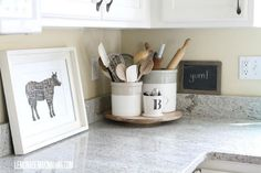 Love this lazy Susan for organizing kitchen utensil crocks.