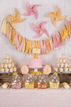 Lula's Lemonade Party: love the oversized pinwheels, fabric strip garland + use of rustic crates for height
