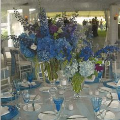 Something Blue? Blue and Purple Centerpiece Arrangement Featuring Hydrangea and Delphinium http://www.busseysflorist.com/bridal-wedding-flowers/