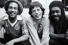 The famous photograph of Mick Jagger squeezed between Bob Marley and core member of The Wailers, Peter Tosh, backstage at the Palladium Theatre, New York in 1978. Putland says: 'Mick had just come off stage so that's why he looks like that and it was just a lovely atmosphere backstage.'