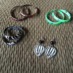 Bundle of earrings! Green with star cut out hoops, brown zebra print and silver hoops, black and white zebra print, and heart shaped zebra print dangling earrings! Jewelry Earrings
