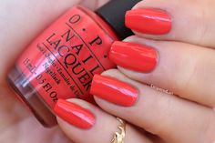"""Aloha From OPI is one of my faves in the lot. It's a brilliant """"almost coral"""" but the color reminds me more of a red island flower, maybe I've seen this on a hibiscus? Gorgeous with a tan. I used 2 coats and it's pretty amazing."""