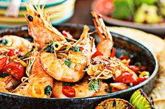 Cooked in warm, fragrant chilli oil, these prawns are a little messy with the shells on, but that's where the flavour is. Chilli Prawns, Garlic Prawns, Prawn Shrimp, Prawn Recipes, Seafood Recipes, Fresh Seafood, Fish And Seafood, Crab And Lobster, Fresh Coriander