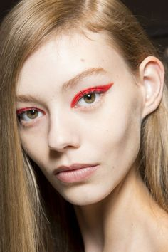 Bright red cat eyes and side-parted tresses at MaxMara