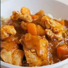 Slow cooker apricot chicken stew. Chicken with dry white wine,apricot jam and vegetables cooked in slow cooker.Apricot jam and Dijon mustard flavor the wine sauce in this easy and delicious chicken stew.