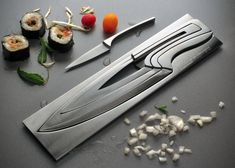 Deglon Meeting Knife Set.  Constructed from high quality stainless steel, the knife set appears to be crafted from a single block with each smaller knife nested within its larger counterpart – a nesting knife set. There are 4 different knives featured in the set - a pairing knife, utility knife, chef knife and a slicer.  Grab the handle and you're ready to start cooking