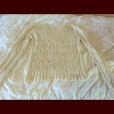 """White knit sweater Not Madewell. Just needed exposure. Cute ivory knit sweater with ruched shoulders. Slim fitting. 32"""" bust. From a Seattle boutique but tags cut off to make it comfy to wear. Great condition. Madewell Sweaters Crew & Scoop Necks"""