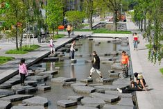 Allowing people to experience the water feature by walking through it.   Project: Roombeek the Brook Landscape Architecture: Buro Sant en Co Client: Municipality of Enschede Location: Enschede, The Netherlands,2005