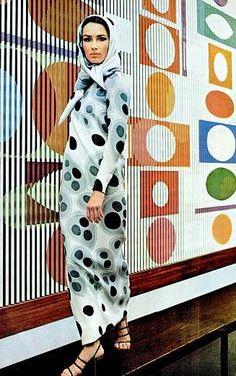 Model in Geoffrey Beene's hooded tubular dress in Op-art circular pattern   Photo Milton Greene, 1965