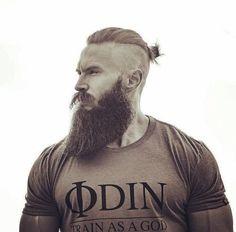 Man with topknot & long beard.