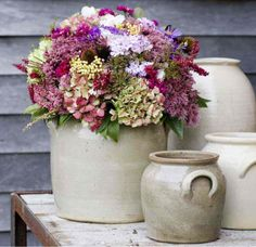 Collection of ironstone crocks and a gorgeous floral arrangement.