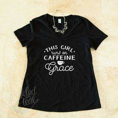 Dress them up or down, these tees are the perfect accent to any outfit! With 6 fun & sassy statements & multiple color options, everyone is sure to find something they will love!60/40 Cotton Poly BlendSayings:All I need today is a little bit of Coffee and a whole lot of JesusBlessedThis girl runs on Caffeine and GraceRunning on FaithFaith. Hope. Love.Pray Coffee RepeatSizing:Small: 0-6Medium: 8-10Large: 12-14X-Large:16-18Fits true to size. Colors may vary from monitor to monitor