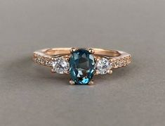 London Blue Topaz Ring Rose Gold Oval Natural London Blue Topaz Simulated Diamond Stones Sterling Silver Engagement Promise Ring by SimplySilvery on Etsy