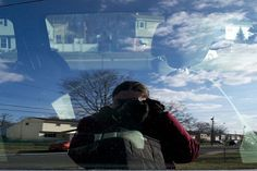 Danielle Rackowski  @danielle4photo  https://twitter.com/danielle4photo  I enjoy finding & photographing myself in unexpected places. It changes how I see myself in a destination. It's as if myself and the place I discover become one. I took this photo through a car window so you can see the reflection of myself the inside of the car and the outside of the car. I titled this piece Reflections. This is one of the first self portraits I've done and I'm really proud that it was featured in…