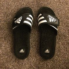 Black and White Adidas Slides Sandals Worn a few times. Size 7 woman's. Great condition. MAKE AN OFFER through the offer button! No trades. Bundle and save :) Adidas Shoes Sandals