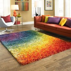 With its dramatic rainbow coloring and thick pile, this shag rug instantly transforms the look of your room. The rug is crafted with durable polypropylene and polyester, which is designed to last and feels comfortable under your feet.
