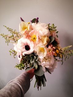 Rustic and wild wedding bouquet with peonies anemone ranunculus succulents  and poppies by Lizy's Lilies