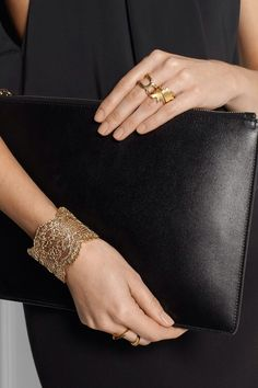 black bag and black clothes, gold jewelry