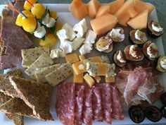 The same teatime tray as before.  Cantaloup, fresh figs with mascarpone, prosciutto, preserved black walnuts, soppressata, imported cheese, cream cheese, mini Caprese salads on toothpicks, pepper toast, and roast beef on toast.