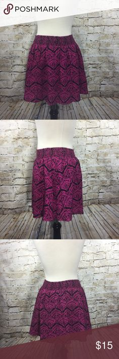 """Pink  Black Print Elastic Waist Skirt Size Medium Pink and Black Print Elastic Waist Skirt.  Perfect for the summer.  Wide elastic waist. Bright pink color.  Fully lined.  Material: 100% rayon; lining: 100% cotton.  Approximate measurements (measured flat):  waist: 13"""", length: 15"""".  Excellent used condition. No signs of wear. Skirts"""