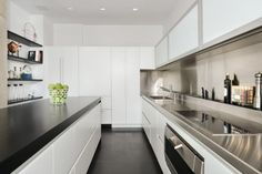 Looking for Modern Kitchen and Galley Kitchen ideas? Browse Modern Kitchen and Galley Kitchen images for decor, layout, furniture, and storage inspiration from HGTV. White Galley Kitchens, All White Kitchen, Modern Kitchen Backsplash, Modern Kitchen Cabinets, Backsplash Ideas, Kitchen Floor, Galley Kitchen Design, Modern Kitchen Design, Kitchen Designs