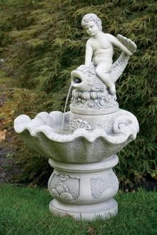 This fountain features a cherub-like small boy riding a dolphin with water pouring from the fish's mouth into a large shell shaped bowl. Concrete Fountains, Stone Fountains, Garden Fountains, Country Cottage Garden, Cottage Garden Design, Cement Garden, Stone Statues, Fish Shapes, Cast Stone