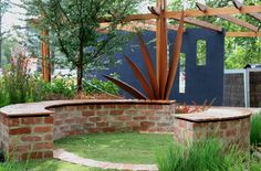 Recycled red brick cap on retaining walls