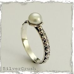Handmade, delicate, floral band with a fresh water pearl on top.  $40