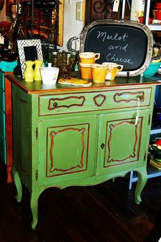 MAKANDJILL 39 GREEN FRENCH CABINET.JPG    French cabinet painted a mix of CHALK PAINT® Antibes Green and Olive over Provence.  I rubbed back some of the green to show the Provence, and left the carved details natural wood.  Then clear and dark waxed, and distressed.  Ooh la la!  www.MAKandJill.com