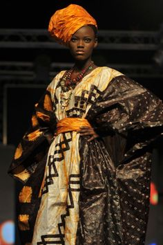 A model wears a creation by iconic designer Alphadi of Niger during Senegal Fashion week
