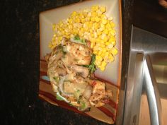 Baked tilapia with cheese sauce and corn