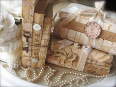 Spineless books tied with ribbon and twine - embellished with vintage skeleton keys, buttons and clock faces