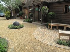 Buff Sandstone Plank Paving' Flint Gravel' Cedagravel' Yellow Quartz Paddlestone Walling' Porphyry Setts and Golden Flint Gravel Buff Sandstone & Flint Gravel PrivateGardens_patios_paving