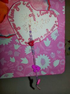 This card has dangling hearts and beads!