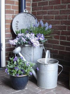 Vintage galvanized containers with flowers for porch decor