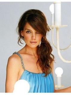 Katie Holmes. Side ponytail. Would look great on bridesmaids with the dresses I have picked out