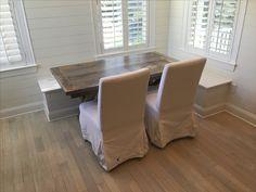Custom reclaimed oak barn wood farm table in an adorable breakfast nook. Built from authentic reclaimed wood in Charleston, SC.