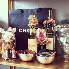 Apartment Decorating on a Budget  - use wine bottles from special places or special occasions to hold bracelets. Now they are visible reminders and put to good use!