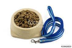 """Download the royalty-free photo """"The close up of kibbles (dog food) in brown plastic dog bowl and blue nylon leash."""" created by phasuthorn at the lowest price on Fotolia.com. Browse our cheap image bank online to find the perfect stock photo for your marketing projects!"""