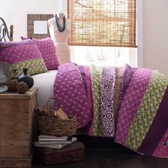 3-piece cotton quilt set with multicolor floral striping.  Product: 1 Full/Queen quilt and 2 shamsConstruction Mater...