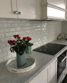 Bevelled subway tiles in my classic white and grey kitchen.