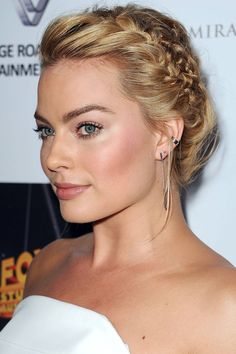 Who: Margot Robbie What: A Textured Side Braid How-To: Robbie made a big beauty statement last night with glittery eye shadow, ear cuffs and an intricate braid—and it totally paid off. Loosely French braid along the front of your head to your ear, then make another smaller, tighter braid behind the first and connect them together at the back of the head. Mist with texturizing hairspray for all-night volume and hold. Editor's Pick: Wella Ocean Spritz Beach Texture Hairspray, $17, ...