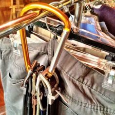 Loop belt buckles onto a carabiner, clip it onto your clothing rack, and step back.
