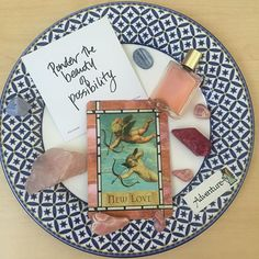 This week's plate of inspiration features the New Love card from the #voyagerdeck, the adventure card from #angelcards and a rocking #truthbomb. Aura Soma bottle #95 needed to be here - it's about communicating our true purpose in the world. Crystals, courtesy of Mother Nature, include rhodochrosite (selfless love and compassion), ruby Aqua Aura (brings in passion and vitality), some blue lace agate (a healing, cooling, calming stone).