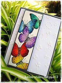 """handmade card: L'universo di Eu: Tecnica """"masking"""" ... wide column of brightly colored butterflies ... delicate embossing folder flowers on background ... beautiful!"""